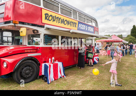 Routemaster bus used as mobile food van or burger bar at an English summer fair - Stock Image