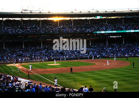 Chicago's MLB baseball stadium Wrigley Field is where the Chicago Cubs play baseball. Night game Cubs vs Cincinnati Reds. - Stock Image