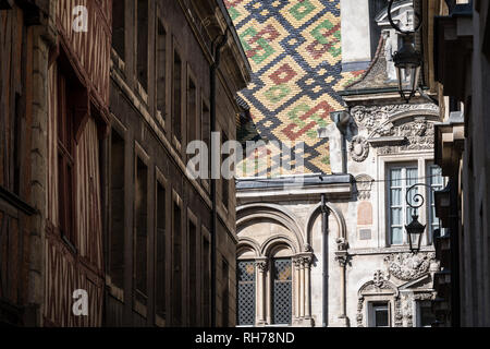 Carvings and features of historic buildings in Dijon, France - Stock Image