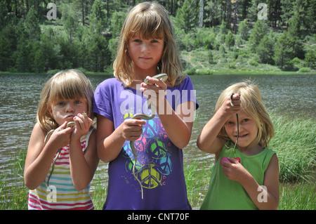 young girls garter snake smile happy wildlife reptile animal youth female - Stock Image