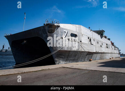 180827-N-RG482-133    CONSTANTA, Romania (Aug. 27, 2018) The Spearhead-class expeditionary fast transport ship USNS Carson City (T-EPF 7) pier side in Constanta, Romania, Aug. 27, 2018. Carson City is the seventh of nine expeditionary fast transport ships in Military Sealift Command's inventory with a primary mission of providing rapid transport of military equipment and personnel in theater via its 20,000 square foot reconfigurable mission bay area and seating for 312 passengers. (U.S. Navy photo by Mass Communication Specialist 1st Class Kyle Steckler/Released) - Stock Image