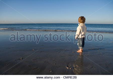 Boy the the sea - Stock Image