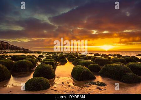 Hunstanton beach at sunset. - Stock Image