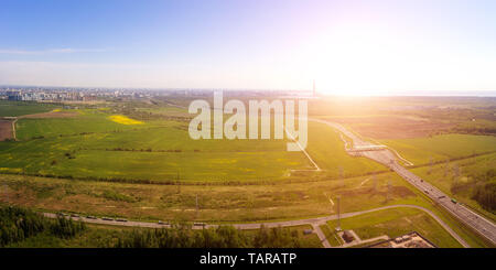 Idyllic rural landscape at entrance to Saint Petersburg, Russia at sunny day. Panoramic aerial view. - Stock Image