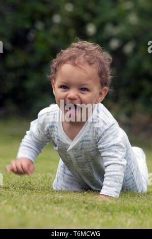 happy baby crawling - Stock Image