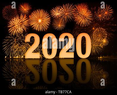 Orange 2020 happy new year fireworks - Stock Image