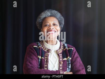 Portrait confident, smiling senior woman - Stock Image