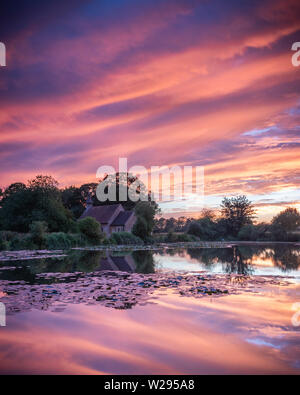 A pond reflections at sunset - Stock Image