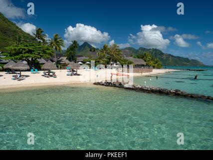 Over the water bungalows at the Hilton Lagoon Resort and Spa, Papetoai, Moorea, Tahiti, French Polynesia - Stock Image