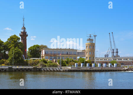 Nowy Port Lighthouse next to Gdansk Harbor Masters Office, Gdansk, Poland, Europe.  The first shots of WWII were fired from here. - Stock Image