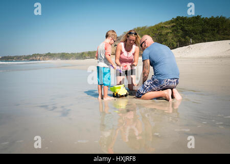 Father, mother and toddler son playing with toys - Stock Image