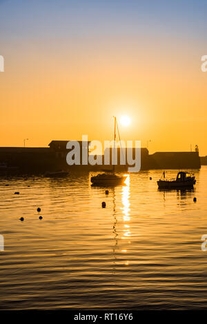 Penzance, Cornwall, UK. 27th Feb, 2019. The sun rises over boats in the harbour at Penzance. Credit: Simon Maycock/Alamy Live News - Stock Image