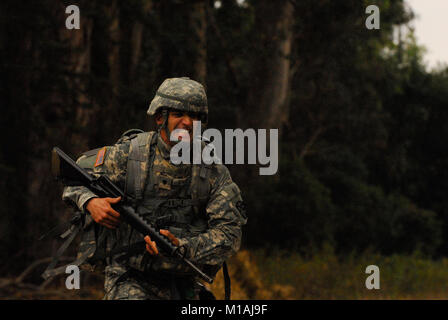 100915-A-2426L-009 A Soldier nears the finish of the ruck march event Sept. 15 at the 2010 Best Warrior Competition. - Stock Image