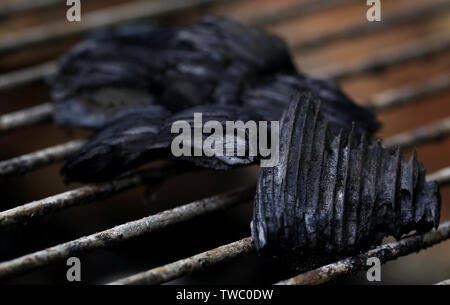 Closeup of some charcoal for barbecue making - Stock Image