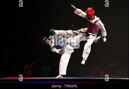 Korea's Jun Jang (left) on his way to winning his semi final of the Men's -58kg against Argentina's Lucas Guzman, during the World Taekwondo Championships at Manchester Arena. - Stock Image