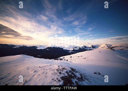 Scenic view of snowcapped mountain against sky - Stock Image