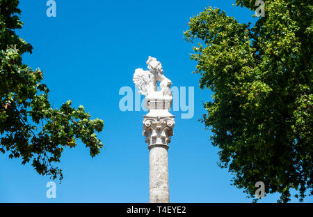 A statue of a surrealistic lion with a broken tail sitting on a Roman column at the north end of La Alameda in Seville - Stock Image