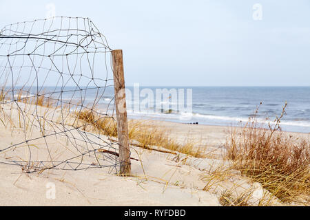 Fence on a beach dune, selective focus. - Stock Image