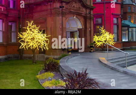 14 December 2018 Slieve Donard Hotel Newcastle County Down. Christmas lights at the entrance to this luxurious Hotel in the late afternoon dusk. These - Stock Image