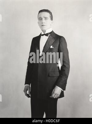 Man in formal white collar and tuxedo - Stock Image