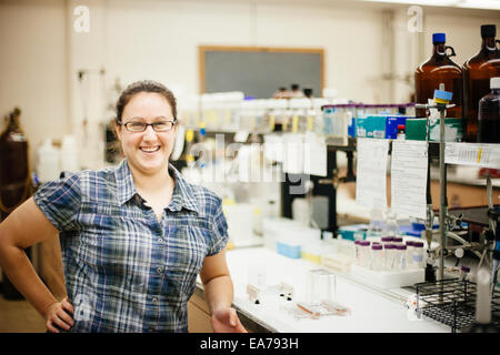 Portrait of smiling mid-adult woman in laboratory - Stock Image