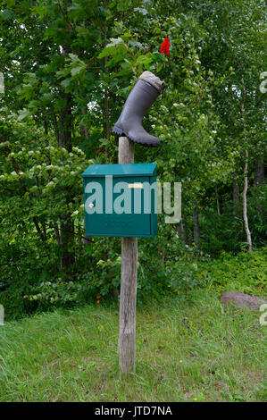Kihnu post box decorated with a boot and a flower. Island Kihnu, Estonia 5th August 2017 - Stock Image