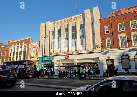 H&M store and shops on street in Brixton Hill, South London England UK - Stock Image