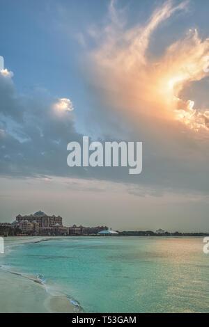 View of Emirates Palace against epic clouds, Abu Dhabi, UAE - Stock Image