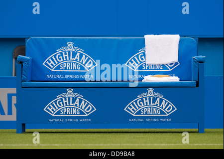 An empty players bench courtside at the Aegon International tennis tournament, Eastbourne. Towels and a banana are - Stock Image