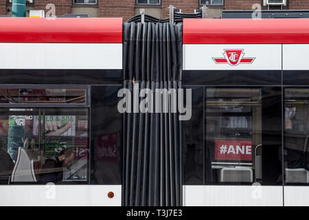 TORONTO, CANADA - NOVEMBER 13, 2018: TTC logo on a New Streetcar in Downtown Toronto, Ontario. Toronto Transit Commission is the operator of public tr - Stock Image