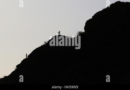 Hiker on mountain Sonoran desert Tuscon Arizona - Stock Image