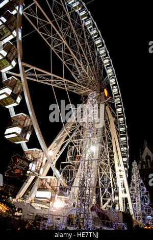Ferris wheel at night in Gent Christmas market - Stock Image