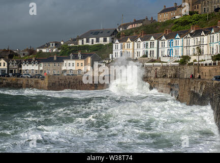 Waves crashing over the harbour wall at Porthleven in Cornwall, England, UK - Stock Image