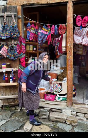 Azerbaijan, Ismailli region, Lahij (Lahic), shop selling traditional woolen slippers - Stock Image
