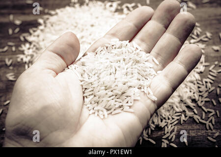 Male Hand Holding A Bunch Of Rice, Monochrome Colors - Stock Image
