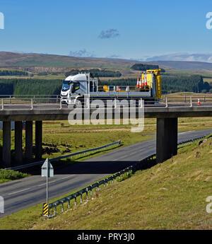 Motorway maintenance vehicle on bridge. M6 Southbound carriageway, Shap, Cumbria, England, United Kingdom, Europe. - Stock Image