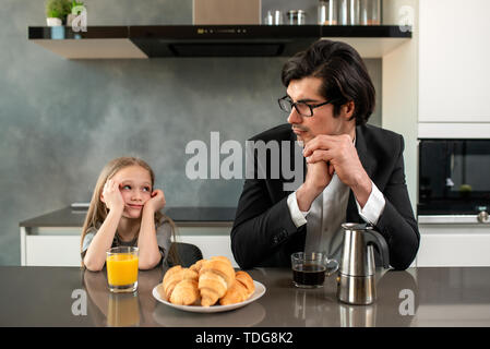 Father and daughter both annoyed and unhappy - Stock Image