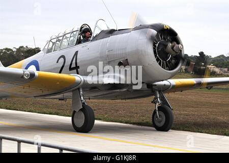 North American Harvard restored airplane on the tarmac at Tyabb airshow, 2016, Australia. - Stock Image