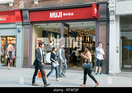 Muji shop with people passing, Long Acre Covent Garden London England Britain UK - Stock Image