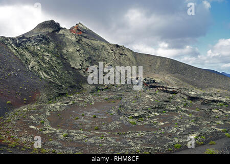 Timanfaya National Park is a pristine volcanic region in Lanzarote (one of the Canary Islands). Shown here is the Pico Partido Volcano. - Stock Image