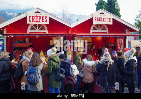 Crepes and Racelette stall in outdoor festive market in Montreux. - Stock Image