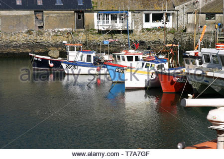 Boats moored in Polperro harbour, Cornwall, UK - Stock Image