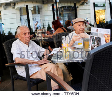 People sitting at  cafe restaurant  in Barcelona in Catalunya in Spain in Europe - Stock Image