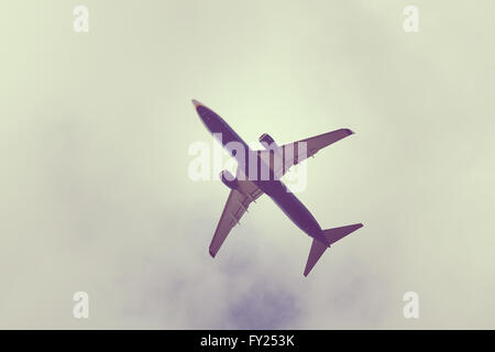 Passenger airplane directly above - Stock Image