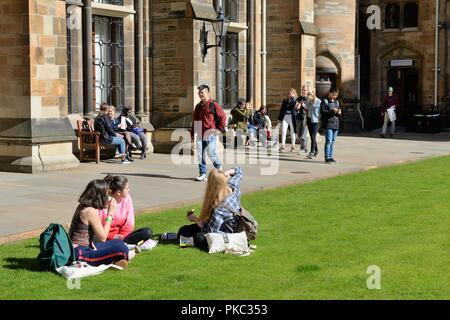 Glasgow, UK. 12th, September, 2018. Glasgow, Scotland, UK. Students sitting in Glasgow University's campus enjoying the warm late summer sunshine during Freshers Week and registration. - Stock Image
