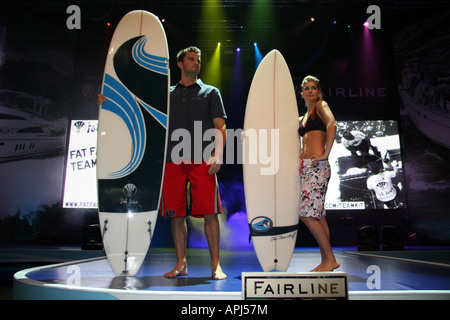fashion models with surf board shorts and tee shirts - Stock Image