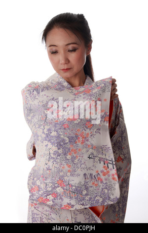 Japanese Lady Wearing a Pink and Lilac Patterned Kimono - Stock Image