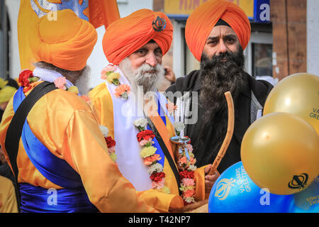 Gravesend, Kent, UK, 13th April 2019. The guards at the front of the procession, followed by the float containing the shrine. Sikh participants wear the traditional kirpan, a dagger or sword, and turban. Thousands of spectators and religious visitors line the streets of Gravesend in Kent to watch and participate in the annual Vaisakhi procession. Vaisakhi is celebrated by the Sikh community all over the world. Credit: Imageplotter/Alamy Live News - Stock Image