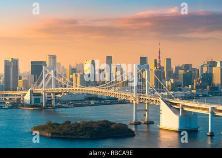 Rainbow Bridge and Tokyo Bay, Odaiba, Tokyo, Kanto region, Japan. - Stock Image