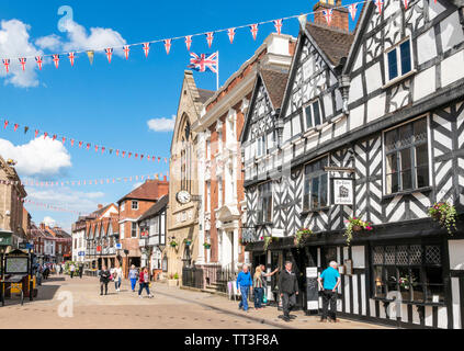 Bunting on Bore street Historic buildings including the Guildhall Donegal house (council offices) and Tudor of Lichfield cafe Bore street Lichfield UK - Stock Image